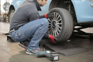 man-changing-a-car-tire-3806249